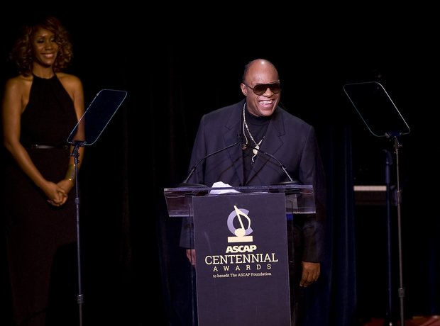 Stevie Wonder watched by partner Tomeeka Roby