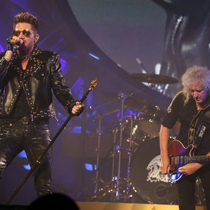 Adam Lambert and Brian May of Queen performing on