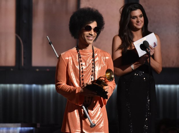 Prince presents the award for Album of the Year at