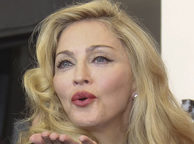 Madonna blows kiss